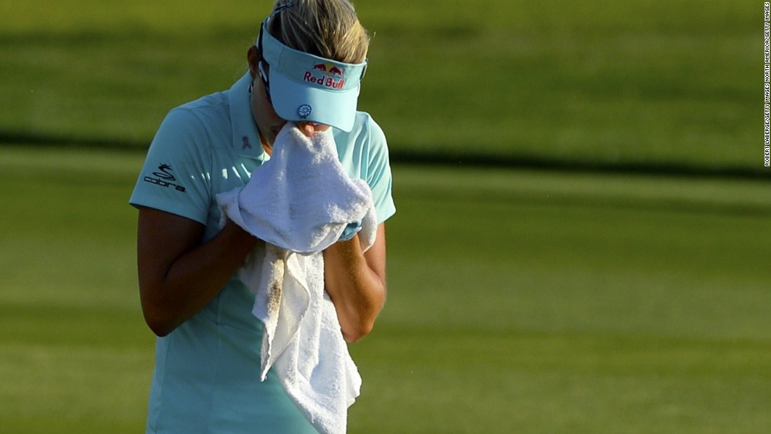 Lexi Thompson cries into a towel during the final round of the ANA Inspiration at the Mission Hills Country Club. The American was on course to win her second major but was denied after a TV viewer spotted she had erred when replacing her ball during her third round. That error would result in a costly four-shot penalty that enabled South Korea's So Yeon Ryu to go on to win.