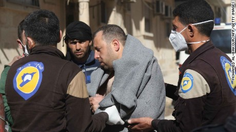 A Syrian man in taken by civil defence workers following a suspected toxic gas attack in Khan Sheikhun, a rebel-held town in the northwestern Syrian Idlib province, on April 4, 2017. 