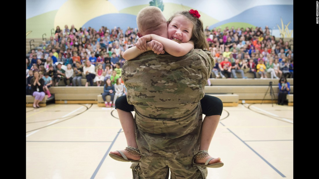 Second-grader Imogen Nowak cries in the arms of her father, US Army Capt. Erik Nowak, after he surprised her at a school assembly in Sewickley, Pennsylvania, on Tuesday, March 28. He had been deployed since September.