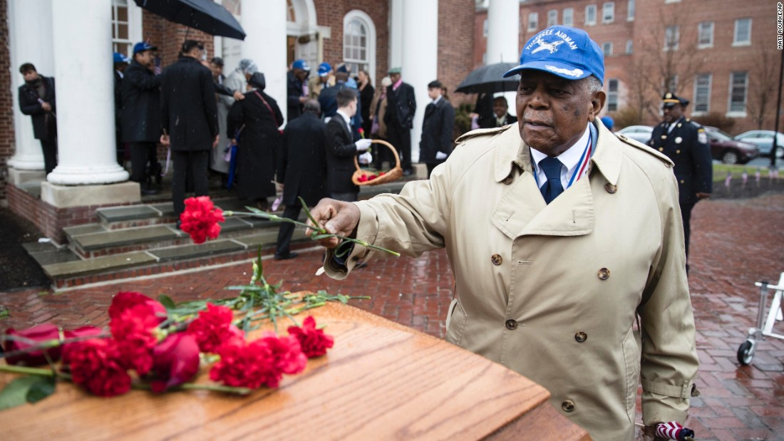 "Eugene J. Richardson Jr. places a flower on the casket of his former comrade, John L. Harrison Jr., at a funeral in Philadelphia on Friday, March 31. Both were <a href=""http://www.cnn.com/2015/01/12/us/feat-tuskegee-airmen-obit/"" target=""_blank"">Tuskegee Airmen</a> who served during World War II."