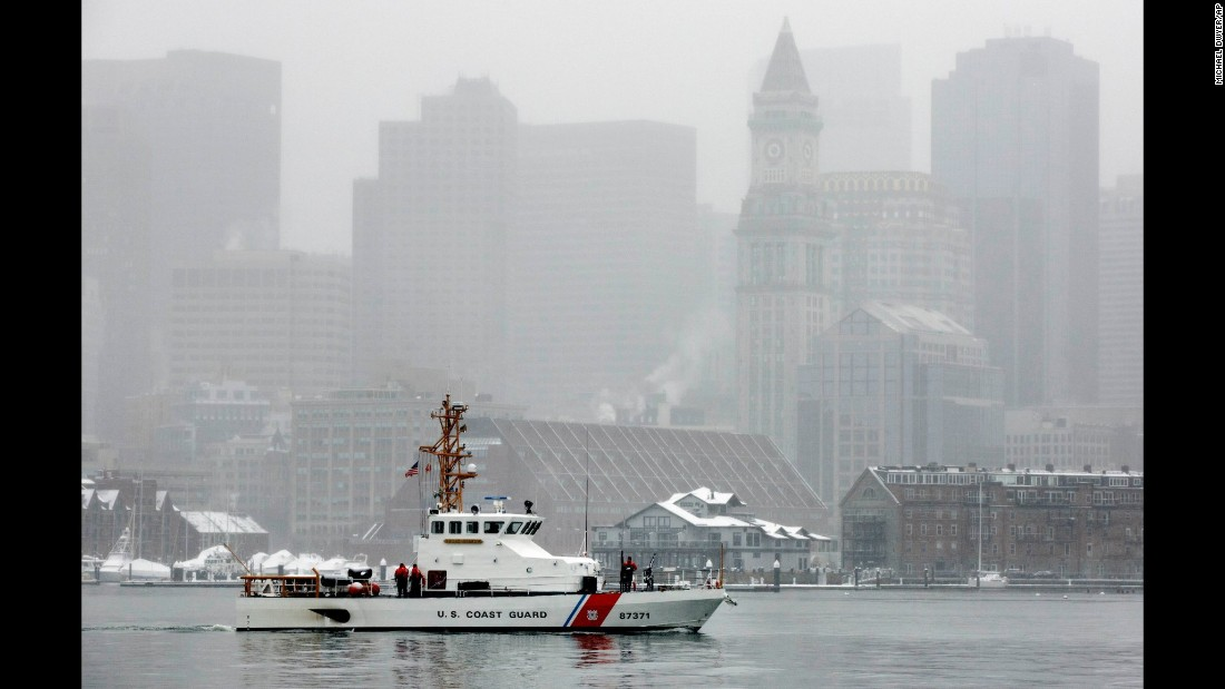 A US Coast Guard boat patrols Boston Harbor as snow falls on Friday, March 10.