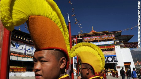 Monks wearing ceremonial headgear at Tawang Monastery.