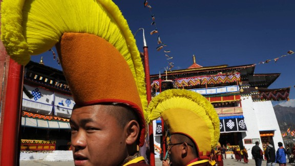 Monks wearing ceremonial headgear at Tawang Monastery.
