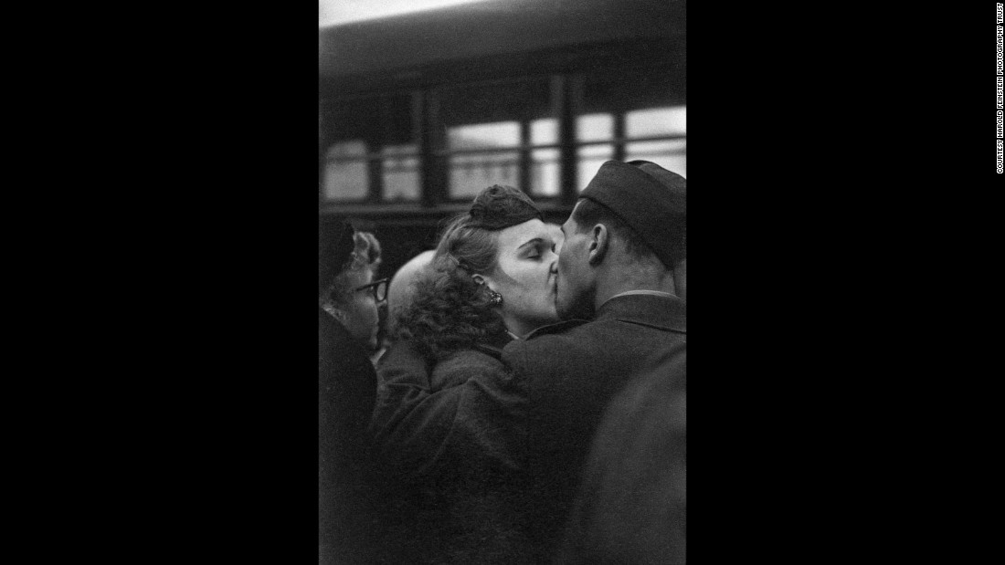 A couple kisses goodbye as a soldier prepares for deployment in 1952. At the time, the United States was involved in the Korean War.