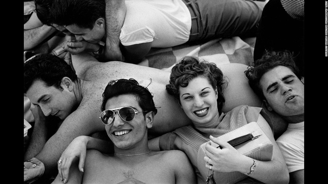 "Teenagers recline on a Coney Island beach in 1949. The photo was taken by Harold Feinstein, a New York City native who was ""a true master of photography,"" according to gallery owner Thierry Bigaignon. Bigaignon's gallery in Paris <a href=""http://www.thierrybigaignon.com/"" target=""_blank"">is showcasing Feinstein's early work,</a> much of which focuses on New York City in the 1940s and '50s. ""He had a way of looking at the world, and he had a way of photographing the world, with a lot of tenderness and a lot of optimism,"" Bigaignon said."
