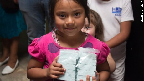 A Guatemalan child holds bars of soap Clean the World distributed in 2015.