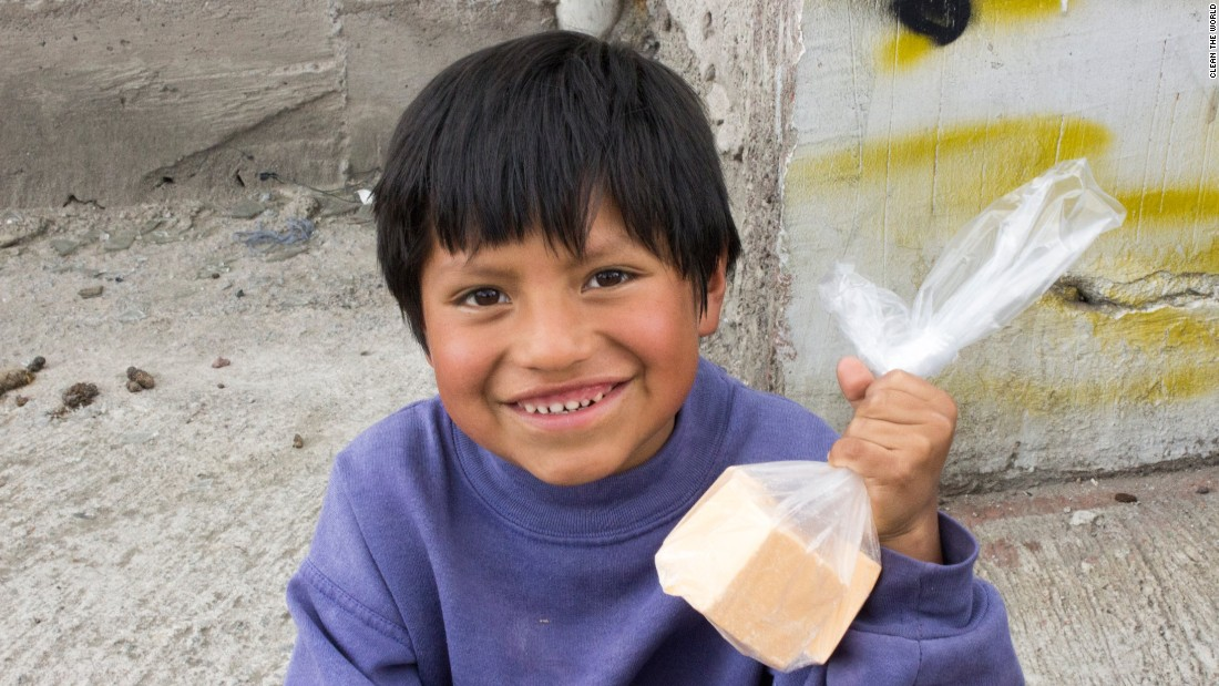 A young boy in Honduras shows off the soap Clean the World gave him during a distribution trip in 2012.