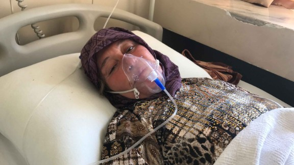 "Aisha al-Tilawi, 55 years old, Mazin's grandmother.  ""the plane hit and I saw blue and yellow. We started choking, felt dizzy, then fainted. Mazin was trying to wake up his grandfather. Three of my family died."""