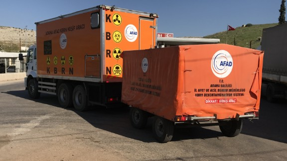 A Turkish lab for detecting nuclear, biological and   chemical weapons is seen crossing the border.