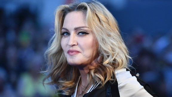 """US singer-songwriter Madonna poses arriving on the carpet to attend a special screening of the film """"The Beatles Eight Days A Week: The Touring Years"""" in London on September 15, 2016. / AFP / Ben STANSALL        (Photo credit should read BEN STANSALL/AFP/Getty Images)"""