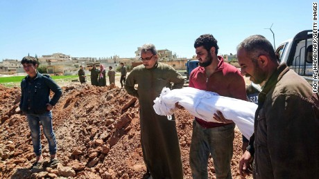 Syrians begin to bury victims of Tuesday's chemical attack.