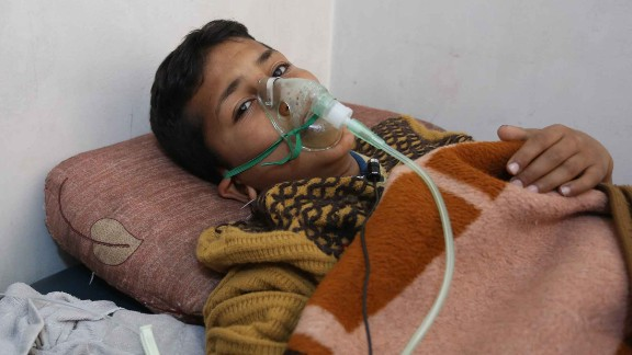 IDLIB, SYRIA - APRIL 05: A chemical gas attack survivor 9-years-old boy, Hassan Dallal, receives medical treatment at an hospital Maarrat al-Nu'man Town of Idlib, Syria on April 05, 2017. On Tuesday more than 100 civilians had been killed and 500 others, mostly children, injured in Assad Regime's suspected chlorine gas attack carried out by  warplanes in the town of Khan Shaykun, Idlib province. (Photo by Mohammed Karkas/Anadolu Agency/Getty Images)