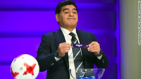 Argentinian football star Diego Maradona holds up the name of Germany during the official draw for the FIFA under-20 football World Cup in Suwon, south of Seoul, on March 15, 2017. The FIFA U-20 World Cup will be held in South Korea from May 20 to June 11. / AFP PHOTO / JUNG Yeon-Je        (Photo credit should read JUNG YEON-JE/AFP/Getty Images)