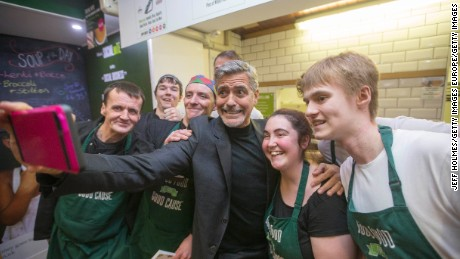 George Clooney met with homeless workers at a cafe which received support from the Hunter Foundation in 2015.