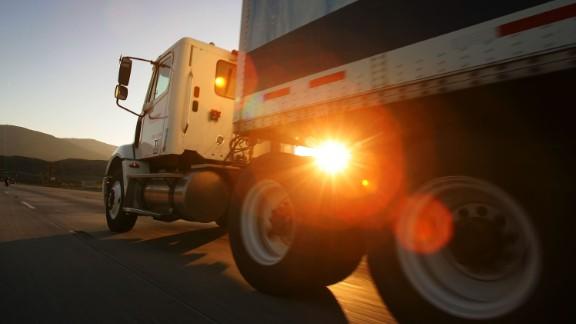 A truck travels the I-210 freeway at dawn near Fontana, California.