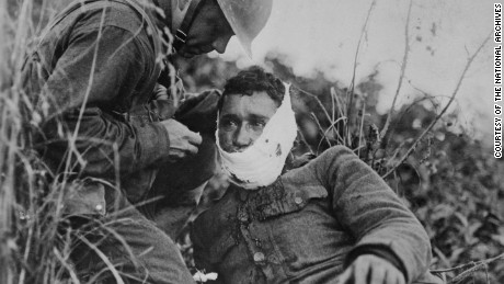 A US soldier treats a comrade's wound in France in 1918. World War I changed the US in ways that linger.