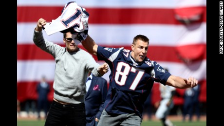 BOSTON, MA - APRIL 3: Rob Gronkowski of the New England Patriots steals Tom Brady's jersey before the opening day game between the Boston Red Sox and the Pittsburgh Pirates at Fenway Park on April 3, 2017 in Boston, Massachusetts. (Photo by Maddie Meyer/Getty Images)
