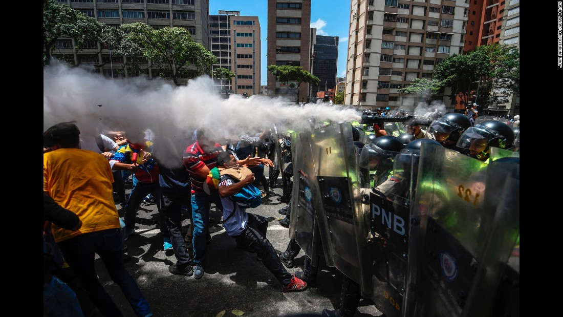 "Opposition activists clash with police as they protest against the Venezuelan government in Caracas on Tuesday, April 4. Last week, the Venezuelan Supreme Court <a href=""http://www.cnn.com/2017/03/30/americas/venezuela-dissolves-national-assembly/"" target=""_blank"">stripped the country's National Assembly of its powers.</a> The National Assembly, Venezuela's legislative body, has had an opposition majority since January 2016."