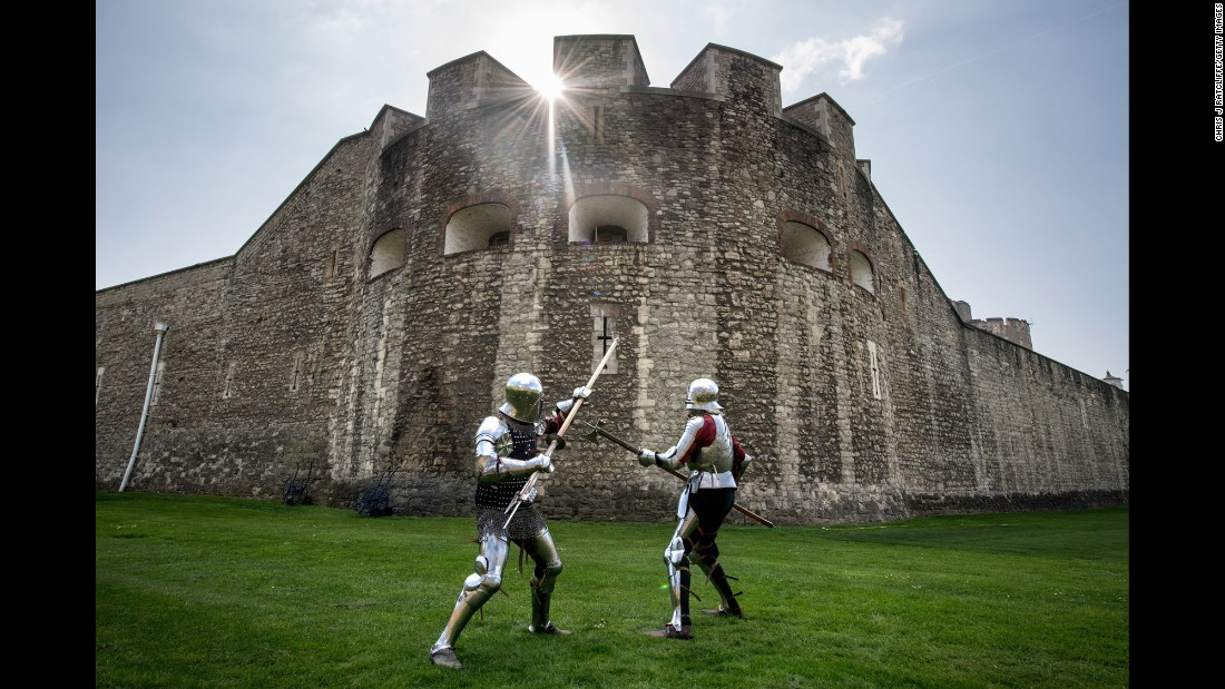 Historical interpreters Mark Griffin, left, and Tom Fermor demonstrate a poleax fight at the Tower of London on Thursday, April 6.