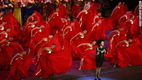 "Vocalist Peng Liyuan, wife of Xi Jinping of the Central Secretariat of the Communist Party of China, sings army's song during the ""Red Army Flag"" theatrical evening at the Great Hall of the People on July 30, 2007 in Beijing, China."
