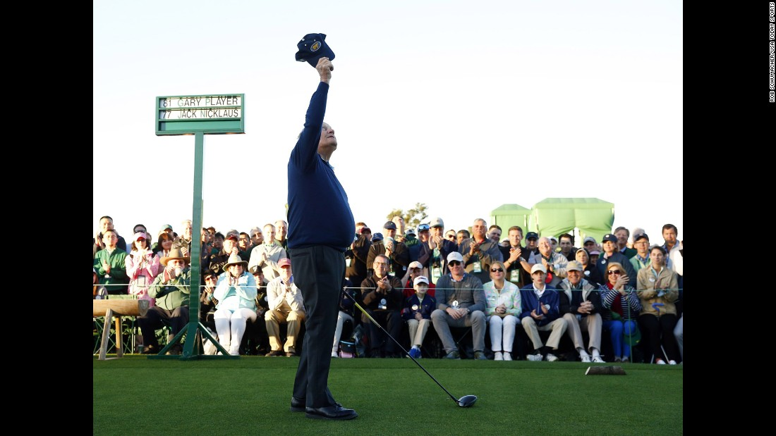 Jack Nicklaus raises his cap to the sky, honoring Palmer before hitting a ceremonial tee shot.