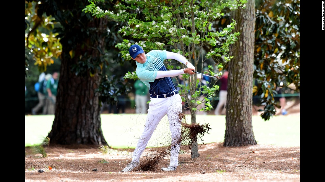 Jordan Spieth plays his second shot on the 18th hole Thursday. Spieth, the Masters winner in 2015, shot a 3-over 75.