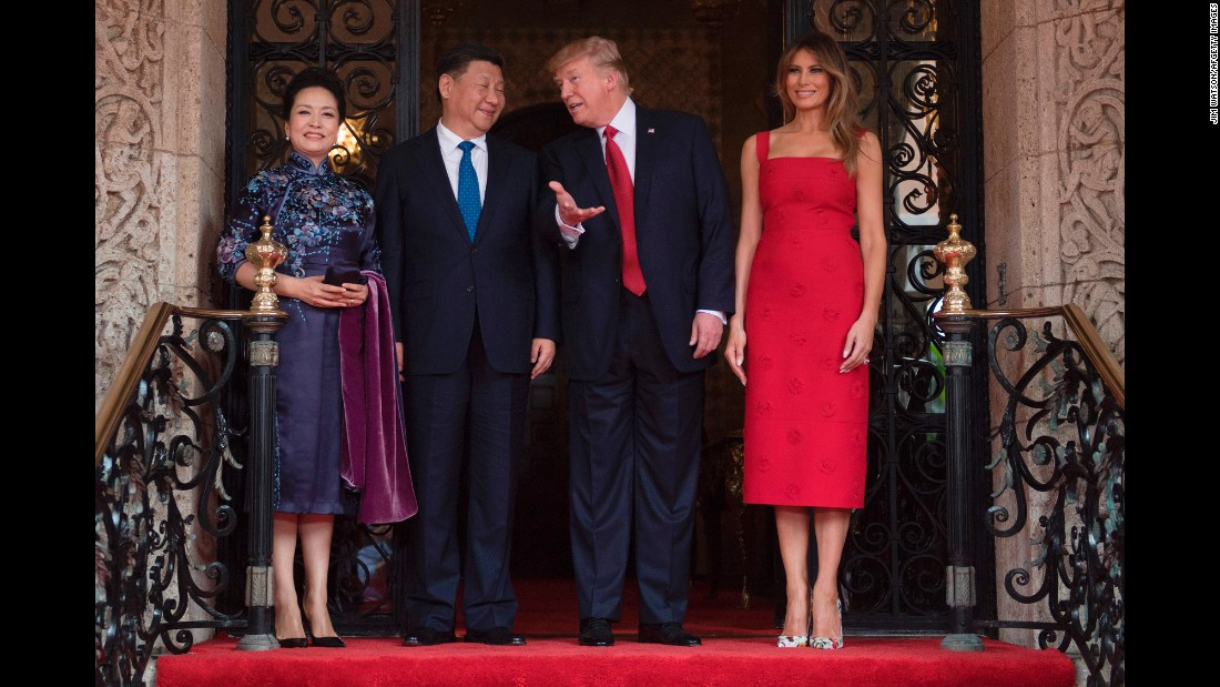 US President Donald Trump talks to Chinese President Xi Jinping at Trump's Mar-a-Lago estate in Florida on Thursday, April 6. They are accompanied by their wives, Peng Liyuan and Melania Trump.