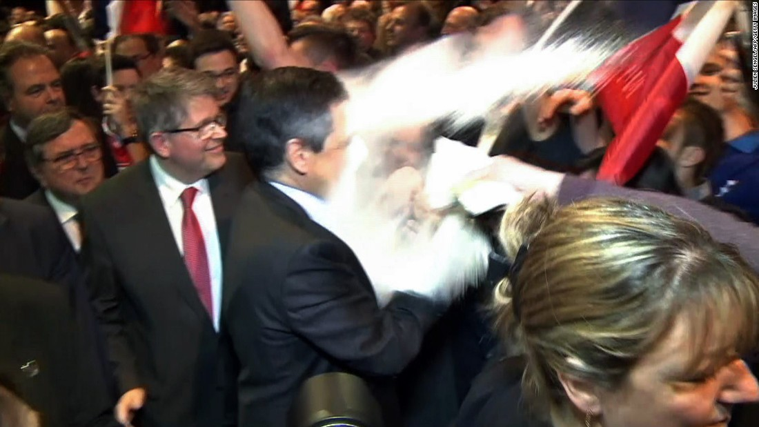 This image, taken from a video recorded on Thursday, April 6, shows a man throwing flour at French presidential candidate Francois Fillon during a rally in Strasbourg, France.