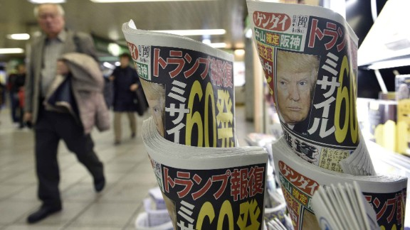 Copies of the Japanese daily newspaper Nikkan Gendai at a railway station in Tokyo show pictures of President Trump.