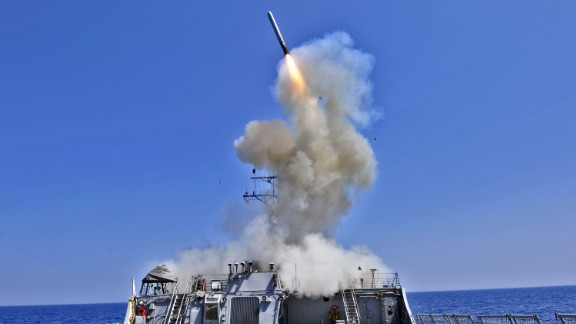 AT SEA - MARCH 29, 2011:  In this handout released by the U.S. Navy, the U.S. Navy guided-missile destroyer USS Barry (DDG 52) launches a Tomahawk cruise missile  in support of Operation Odyssey Dawn March 29, 2011 from the Mediterranean Sea.. In a response to a alleged chemical weapons attack on its own people by the Syrian regime the USS Mahan, the USS Barry, the USS Ramage, and the USS Gravely, all Arleigh Burke-class destroyers carrying Tomahawk land-attack missiles, are en route or in position in the eastern Mediterranean for a possible strike on Syrian military assets on August 28, 2013.  (Photo by U.S. Navy via Getty Images)