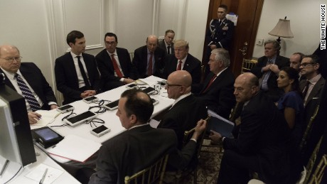 President Donald Trump receives a briefing on a military strike in Syria on April 6, 2017.