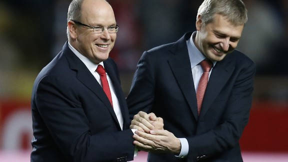 Prince's Albert II of Monaco (L) shakes hands with Monaco's Russian president Dmitry Rybolovlev (R) prior to a Ligue 1 match.