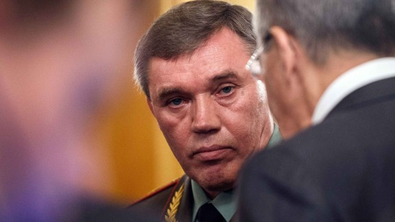 Gen. Valery Gerasimov (C), chief of the Russian General Staff,  speaks to Foreign Minister Russian Foreign Minister Sergei Lavrov in this 2016 file photo.