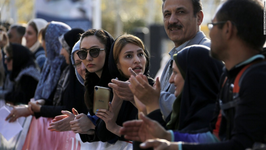 Foreigners and locals watch the first international Tehran marathon at Azadi Square in the Iranian capital.