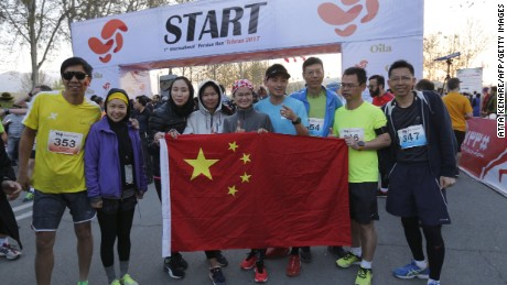 Chinese participants attend the first international Tehran marathon at Azadi Square in Tehran on April 7, 2017.