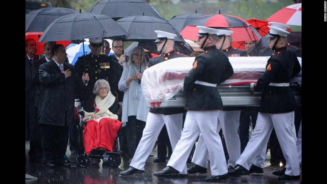 "Annie Glenn, the widow of astronaut John Glenn, watches US Marines carry her husband's casket at Arlington National Cemetery on Thursday, April 6. Glenn, the first American to orbit the Earth, <a href=""http://www.cnn.com/2016/12/08/health/john-glenn-dead/"" target=""_blank"">died in December</a> at age 95."