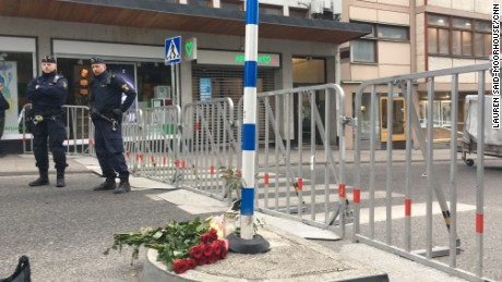 Police officers stand guard Saturday by a cordon surrounding the scene of a truck attack in Stockholm.