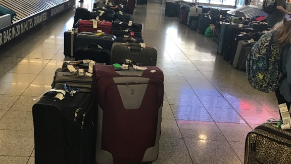 Hundreds of unclaimed bags sat at Atlanta's Hartsfield-Jackson airport on Saturday.