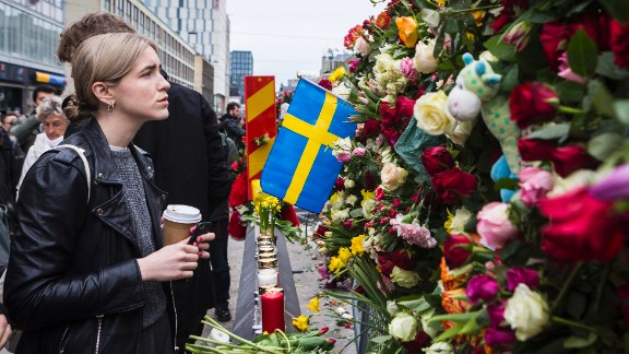 STOCKHOLM, SWEDEN - APRIL 08: A young woman pays her respect at the scene of the terrorist truck attack in downtown Stockholm on April 8, 2017 in Stockholm, Sweden. (Photo by Michael Campanella/Getty Images)