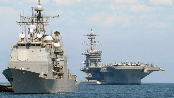 The US aircraft carrier Carl Vinson (R) and the cruiser USS Bunker Hill (L) sit anchored off Manila Bay after arriving on May 15, 2011 for a four-day port of call accompanied by three other warships.  The Carl Vinson is making a port call in the Philippine capital after its crew buried Osama bin Laden's remains in the Arabian Sea   AFP PHOTO / JAY DIRECTO (Photo credit should read JAY DIRECTO/AFP/Getty Images)