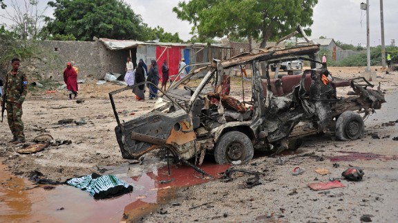 A soldier stands guard in the street after a suicide car attack near the defense ministry in Mogadishu, Somalia, on April 9, 2017. Somali police said the attack was an attempt to assassinate the country's military chief, Ahmed Mohamed Irfid.