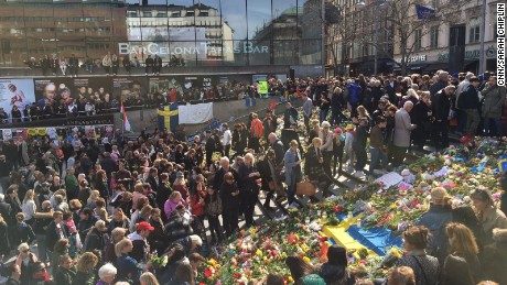 People placed flowers on a Swedish flag in a show of solidarity after the attack.