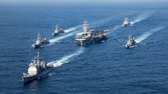 170328-N-FC674-142  PHILIPPINE SEA (March 28, 2017) The Nimitz-class aircraft carrier USS Carl Vinson (CVN 70), the Arleigh Burke-class guided-missile destroyer USS Wayne E. Meyer (DDG 108) and the Ticonderoga-class guided-missile cruiser USS Lake Champlain (CG 57) participate in a photo exercise with Japan Maritime Self-Defense Force destroyers. The Carl Vinson Carrier Strike Group is on a western Pacific deployment as part of the U.S. Pacific Fleet-led initiative to extend the command and control functions of U.S. 3rd Fleet.(U.S. Navy photo by Mass Communication Specialist 3rd Class Kurtis A. Hatcher/Released)