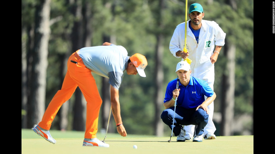 Close friends Jordan Spieth and Rickie Fowler were playing together in the penultimate group Sunday, with Spieth chasing a second green jacket and Fowler a first major title.