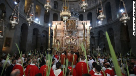 Palm Sunday during the pandemic will be different from this 2017 procession at the Holy Sepulcher in Jerusalem & # 39; s old town.