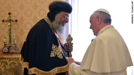 Pope Francis, right, welcomes Coptic Orthodox Church of Egypt Pope Tawadros II at the Vatican on May 10, 2013.