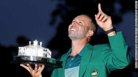 Sergio Garcia of Spain celebrates with the Masters Trophy during the Green Jacket ceremony