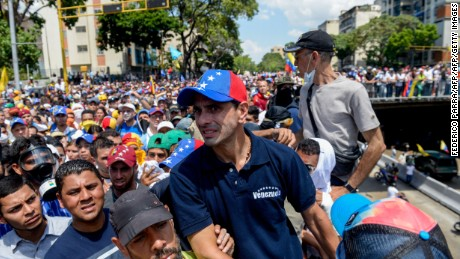 Venezuelan opposition leader Henrique Capriles (C) participates in a mass protest against President Nicolas Maduro's government in Caracas on April 8, 2017.  Venezuelan authorities on Friday banned Capriles from public office for 15 years, the latest move in an increasingly tense power struggle in the crisis-hit country.  / AFP PHOTO / FEDERICO PARRA        (Photo credit should read FEDERICO PARRA/AFP/Getty Images)