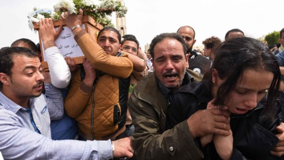 Mourners in Alexandria carry the coffin of one of the blast victims.
