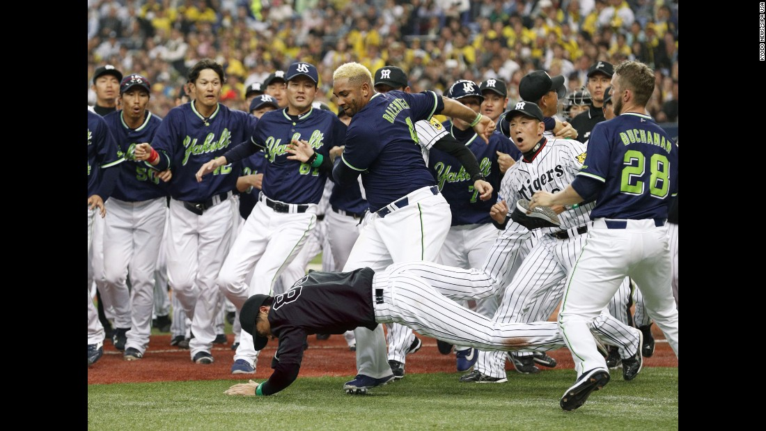 Yakult outfielder Wladimir Balentien shoves over Hanshin coach Akihiro Yano during a bench-clearing scuffle in Osaka, Japan, on Tuesday, April 4. Both were ejected.